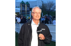 Mark Rolfing wearing NBC Golf jacket and holding mic