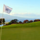 The King Kamehameha Golf Club 18th pin flag Maui coastline background