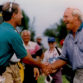 Mark Rolfing and Arnold Palmer shake hands